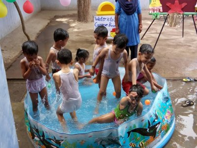 "Students of LKG-A enjoy a pool party during the ""Splash pool and lemonade week "" -  May 22, 2017"